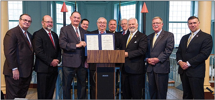 Delaware State News/ Doug Curran (used with permission) The Delaware Veterans Coalition was honored at the historic Old State House on The Green in Dover on its fifth anniversary. L to R: Rep. Earl Jaques; Sen. Dave Lawson; Paul Davis, Coalition VP; Rep. Bill Carson; Dave Skocik, Coalition president; Sen. Brian Bushweller; Rep. Steve Smyk. Back row: Rep Trey Paradee; Joe Startt Jr., VVA Chapter 850 president; and Rep. Harvey Kenton.